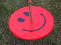 kids red smiley face tree swing with brown rope