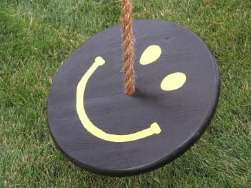 black yellow smiley face tree swing for kids