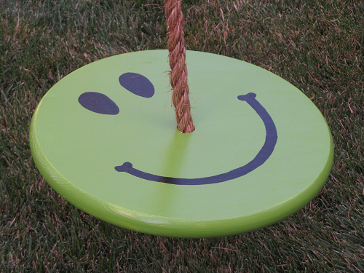 green kids tree swing with brown tree swing rope