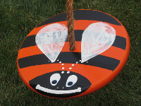 orange bumble bee swing for kids
