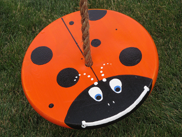 orange lady bug swing